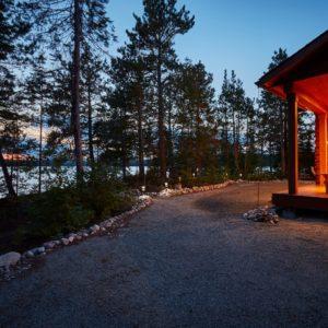 Citadel X True North Log Homes Porch Night